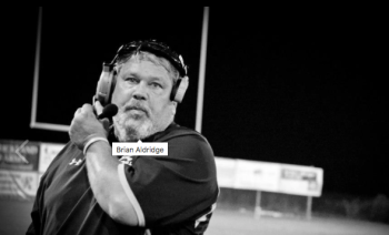 Daddy on the sidelines at Harrells Christian Academy